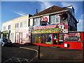 SZ0995 : Muscliff: Castle Lane shops on Muscliffe Lane corner by Chris Downer