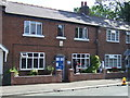 TA0979 : Cottage with scarecrows on West Street, Muston by JThomas