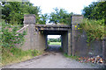 SK4441 : Footpath under a dismantled railway by David Lally