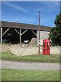 SE7667 : K6 phonebox and flagpole, Huttons Ambo by Pauline E