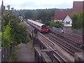 TQ2487 : Train approaching the bridge on Woodstock Road (2) by David Howard