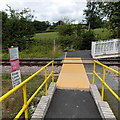 SO0964 : Pen-y-bont railway station level crossing by Jaggery