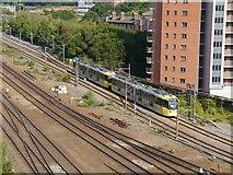 SJ8499 : Tram Approaching Victoria by David Dixon