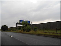 TQ0168 : Thorpe Bypass by the M25 motorway by David Howard
