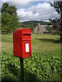 NO4795 : A pillar-mounted rural postbox by Stanley Howe