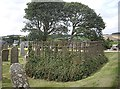 NO7564 : An anonymous lair in St Cyrus churchyard by Stanley Howe