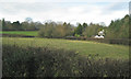 SP1872 : Field and a house by Rising Lane north of Kingswood by Robin Stott