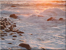 SW3526 : Rock and breakers at sunset in Sennen Cove by Rod Allday