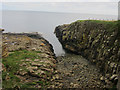 NU2521 : Queen Margaret's Cove, Dunstanburgh Castle by Graham Robson