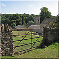 SP0809 : Coln Rogers: dry stone wall and field gate by John Sutton
