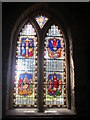 NU2229 : Stained glass window on south side of Church of St Ebba, Beadnell (3) by Graham Robson