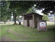 NY9393 : Village sign and shelter, Elsdon by Stanley Howe