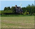 TF5622 : Cottages and wind turbine near the Laurels Farm by Mat Fascione