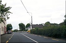 N6468 : Approaching the cross roads at the centre of Clonmellon by Eric Jones