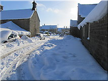 NZ0285 : The village of Cambo under heavy snow by Andrew Tryon