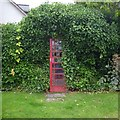 NH5545 : Telephone box in a hedge, Kirkhill by Craig Wallace