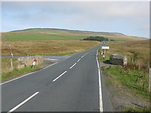 SD7983 : Road Junction and Road Bridge on Newby Head Moss by G Laird