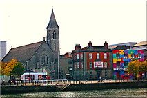 O1634 : Church & Buildings along City Quay along River Liffey by Joseph Mischyshyn