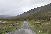 NH2276 : Old Road/Parking space by Peter Moore