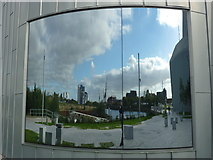 NS5565 : Glasgow Townscape : Geographer Disappears Into Clydeside Mirror by Richard West
