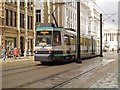 SJ8498 : Metrolink Tram on Moseley Street by David Dixon