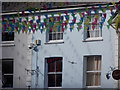SW8032 : Falmouth: bunting and its shadows in Arwenack Street by Chris Downer