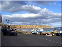 TA1280 : Fishing Boats and Filey Brigg Headland, viewed from the Coble Landing, Filey by Terry Robinson