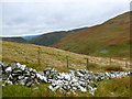 NS9109 : Fence and drystane dyke on Laght Hill by Alan O'Dowd