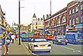 TQ2985 : Northward on Kentish Town Road at entrance to LT and BR stations, 1997 by Ben Brooksbank