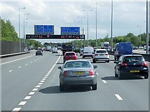TQ0168 : M25 Anti-clockwise, Thorpe Interchange by David Dixon