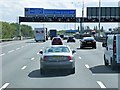 TQ0274 : Overhead Sign Gantry, M25 near Junction 13 by David Dixon