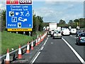 TQ4054 : Anti-clockwise M25, Sign for Clacket Lane Services by David Dixon
