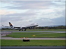 SJ8184 : Airbus A340 Taking Off at Manchester Airport by David Dixon