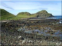 C9444 : The boulder strewn beach at Port Granny by Eric Jones