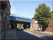 TQ3379 : Repainted railway bridge by Stephen Craven