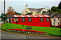 G9278 : Donegal Town - Bright Orange Ashtree Garden Centre by Joseph Mischyshyn