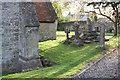 SP6003 : West angle buttress and damaged cross at All Saints Church by Roger Templeman