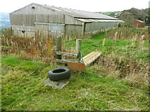 SE0023 : Stile and footbridge on Hebden Royd FP106 by Humphrey Bolton