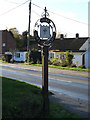 TG2301 : Stoke Holy Cross Village sign by Adrian Cable