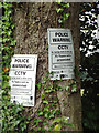 SP1472 : Police Warning notices on a tree, Sadlerswell Lane by Robin Stott