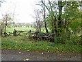 NY3123 : Field gateway and disused harrow by Graham Robson