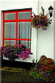 M2208 : Ballyvaghan - White & Red B&B - Red Window & Flowers by Joseph Mischyshyn