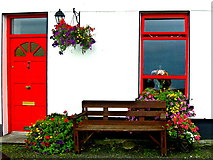 M2208 : Ballyvaghan B&B - White Wall, Red Door & Window, Bench & Flowers by Joseph Mischyshyn