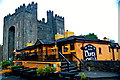 R4560 : Bunratty - 15th Century Bunratty Castle & Front & NW Sides of Durty Nelly's Pub by Joseph Mischyshyn