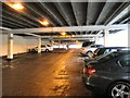 SJ9594 : Looking up the multi-storey car park by Gerald England