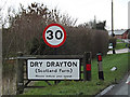 TL3660 : Dry Drayton Village name sign by Adrian Cable