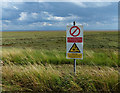 TF4750 : Warning sign on the sea bank by Mat Fascione