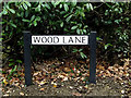 TL2863 : Wood Lane sign by Adrian Cable