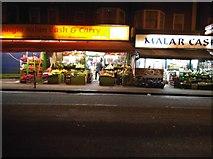TQ1785 : Shop fronts on Harrow Road, Wembley by David Howard