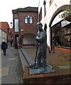SY6990 : Durngate street and the sculpture of a Dorset shepherd and his dog by David Smith